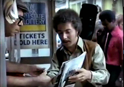 Dustin Hoffman tries to get a copy of Time Magazine on credit